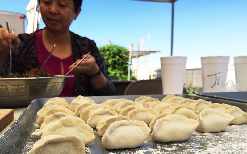 Dumplings have a long history in China. Chinese-Americans in the Phoenix area make dumplings together as friends and family. (Photo by Jiahui Jia/Cronkite News)