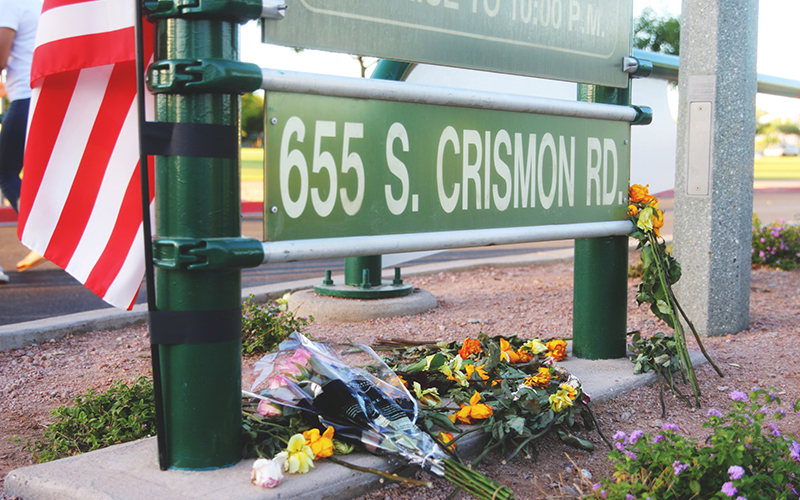 Flowers and an American flag were placed at the entrance of Skyline Park, in remembrance of Orlando victim Jason Josaphat. (Photo by Christopher West/Cronkite News)