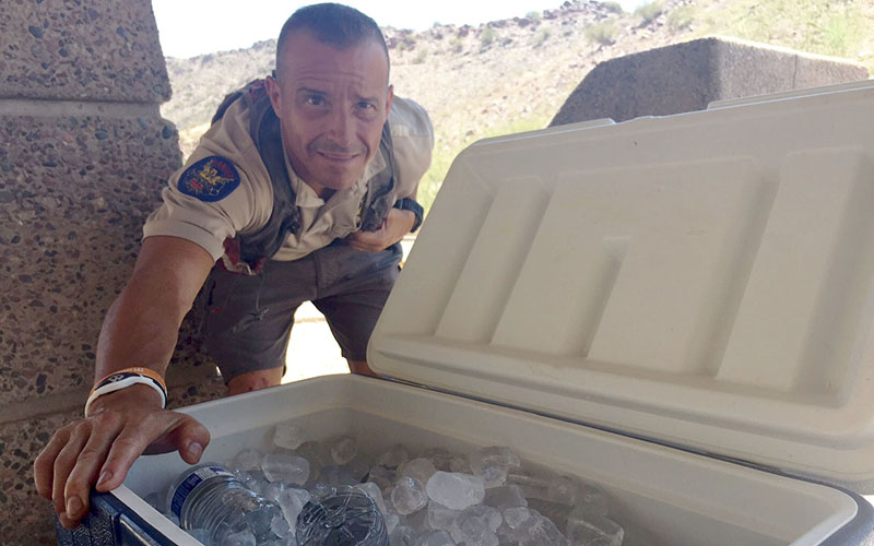Phoenix park ranger David Metzler provides free water to hikers to make sure they are safe. (Photo by Jiahui jia/Cronkite News)