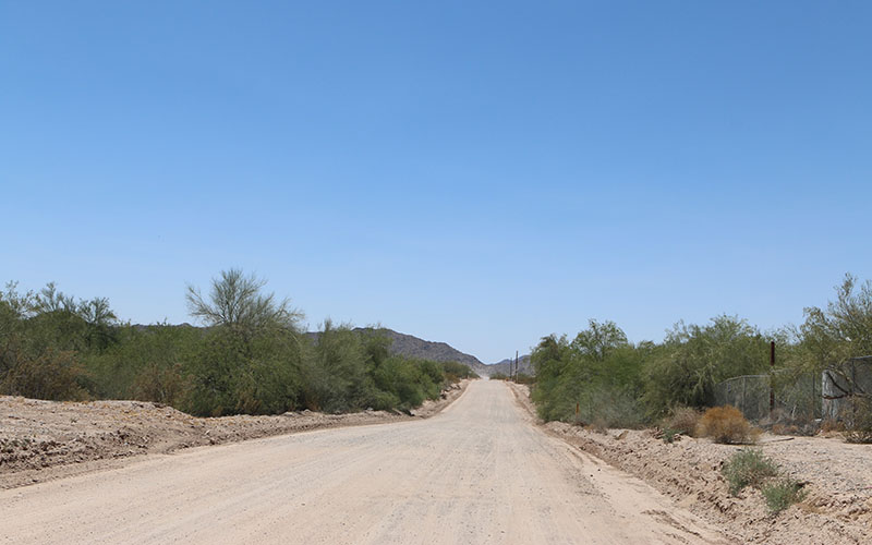 Dirt roads similar to this one in Hidden Valley wind up and down different parts of the neighborhoods. (Photo by Kelsey DeGideo/Cronkite News)