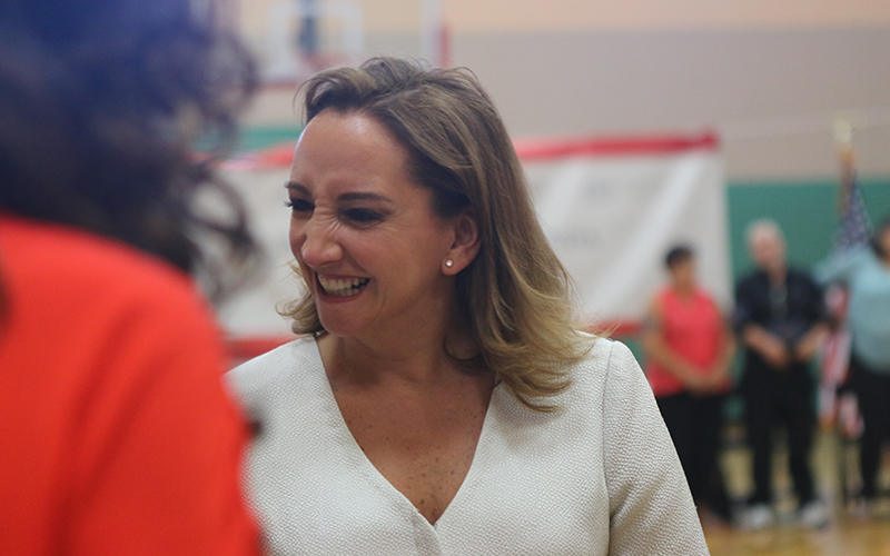 "Claudia Ruiz Massieu, Secretary of Foreign Affairs for Mexico, greets crowd members in Phoenix at ""Construye En Tu Tierra"", a new housing initiative between Sonora and Arizona. (Photo by Socorro Carrillo/Cronkite News)"
