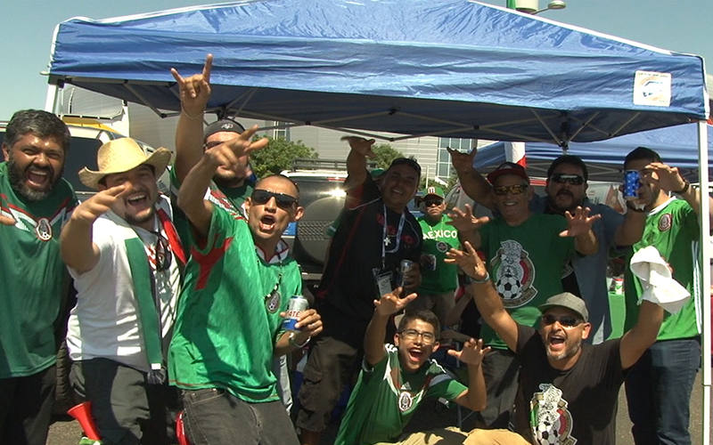 Fans of the Mexican National Soccer Team tailgate before their Copa America match against Uruguay at University of Phoenix Stadium.