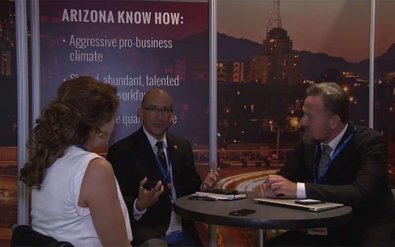 Valentin Hernandez, vice president of business attraction at the Arizona Commerce Authority,networks with other business owners at the summit.(Photo by Wafa Shahid/Cronkite News)