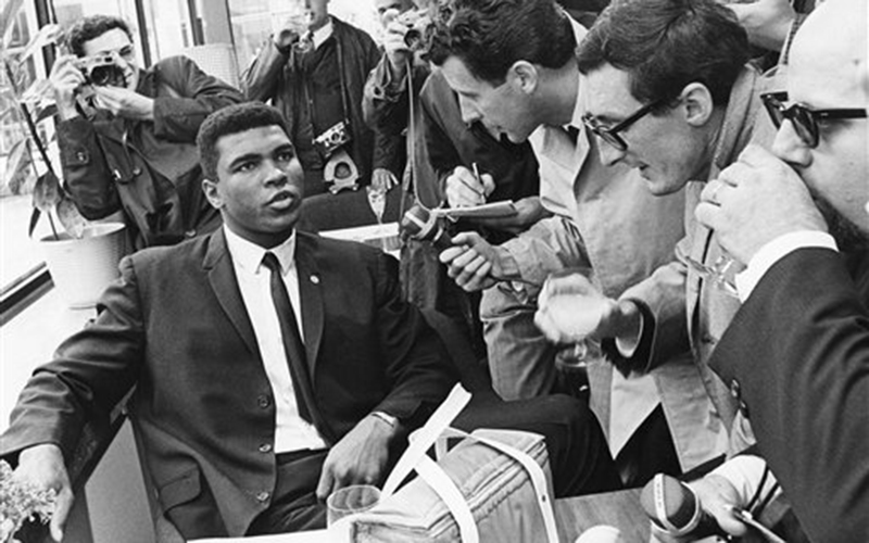 Muhammad Ali, former Cassius Clay, is surrounded by the press after arriving at Frankfurt am Main's, West Germany