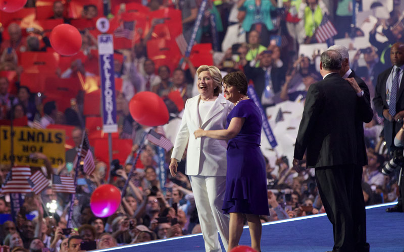 Hilary Clinton is joined by Tim Kaine's wife Anne Holton to conclude the Democratic National Convention Thursday. (Photo by Kelsey DeGideo/Cronkite News)