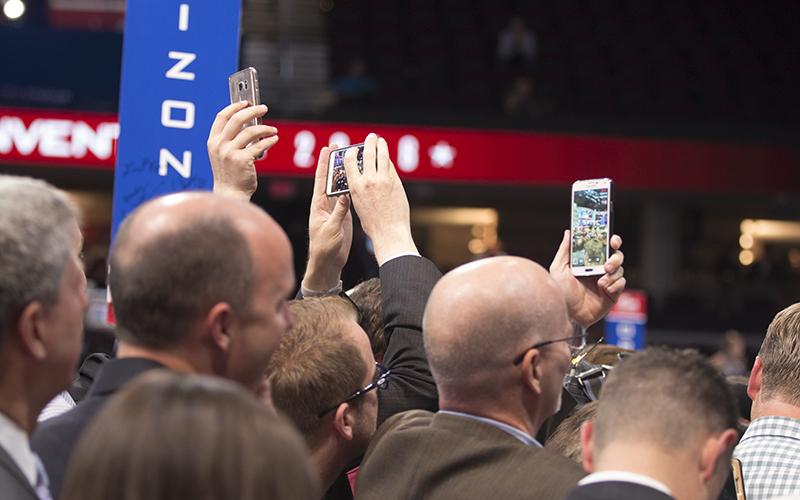 Arizona delegates capture a historic moment during the state roll-call at the RNC. (Photo by Christopher West/Cronkite News)
