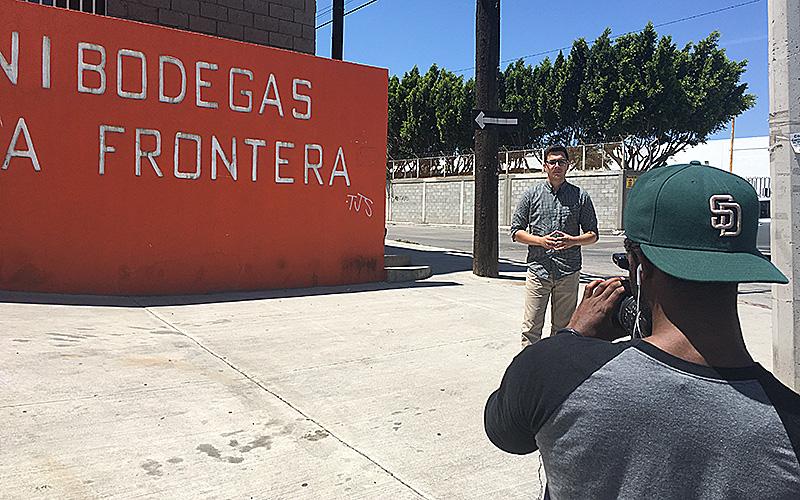 Mauricio Casillas and Cammeron Neely shoot a standup in Tijuana, Mexico.  (Photo by Angela Kocherga/Cronkite News)