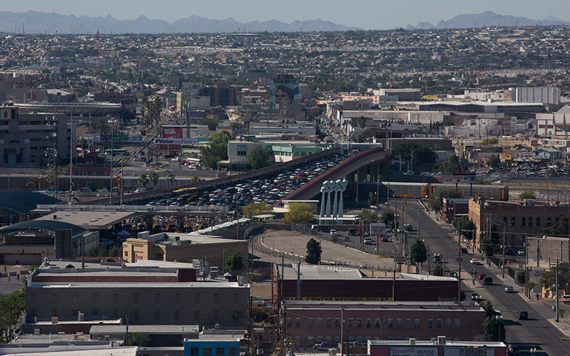 People wait to cross the border into El Paso, Texas from Ciudad Juarez, Chihuahua. (Photo by Courtney Pedroza/Cronkite News)