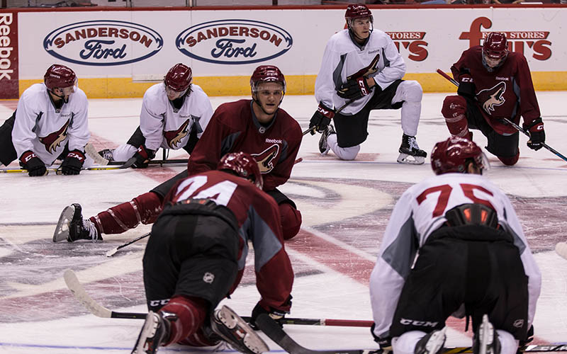 Prospects stretch after their ice session at the Coyotes development camp at Gila River Arena.(Photo by John Alvarado/Cronkite News)