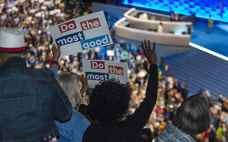 Delegates in the stands at Wells Fargo Center cheer during speeches to nominate Hillary Clinton at the Democratic National Convention in Philadelphia. (Photo by Isabel Menzel/Cronkite News)