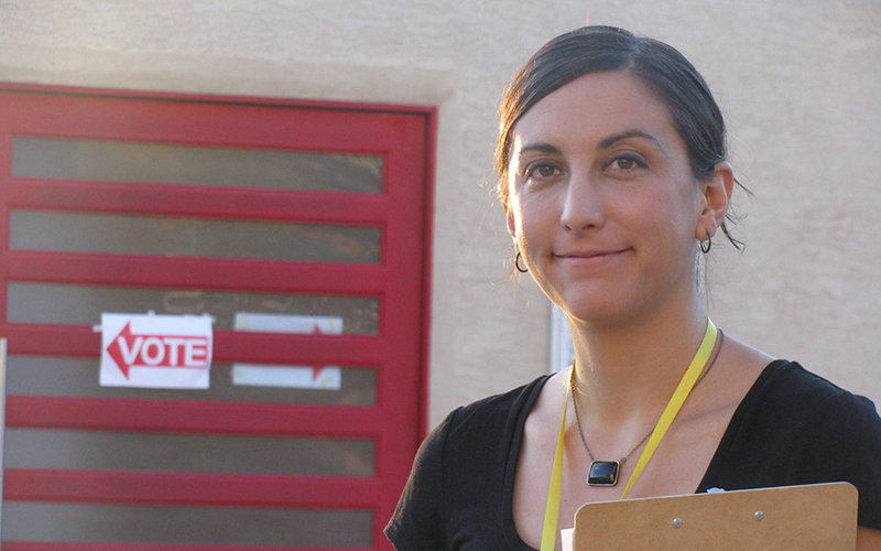 Sam Pstross, executive director of Arizona Advocacy Network, helped ensure election policies were followed at the Knights of Pythias polling location in Tempe on Tuesday. (Photo by Michelle Chance / Cronkite News)