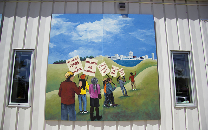 A mural outside of Centro Hispano, a Latino community center in Madison, Wisconsin, captures the unrest of the modern generation of young Latinos - a generation calling for programs like immigration reform. Latino-oriented get-out-the-vote campaigns often aim to channel the potential of these young voters, who make up much of the Latino electorate. (Photo by Sami Edge/News21)
