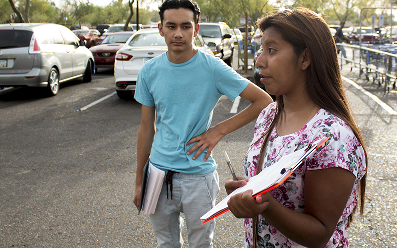 Yenni Sanchez, 18, has registered people to vote for three years. She said that she registers as many people as she can because she isn't eligible to vote. Daniel Flores, 16, is also a volunteer. (Courtney Columbus/News21)