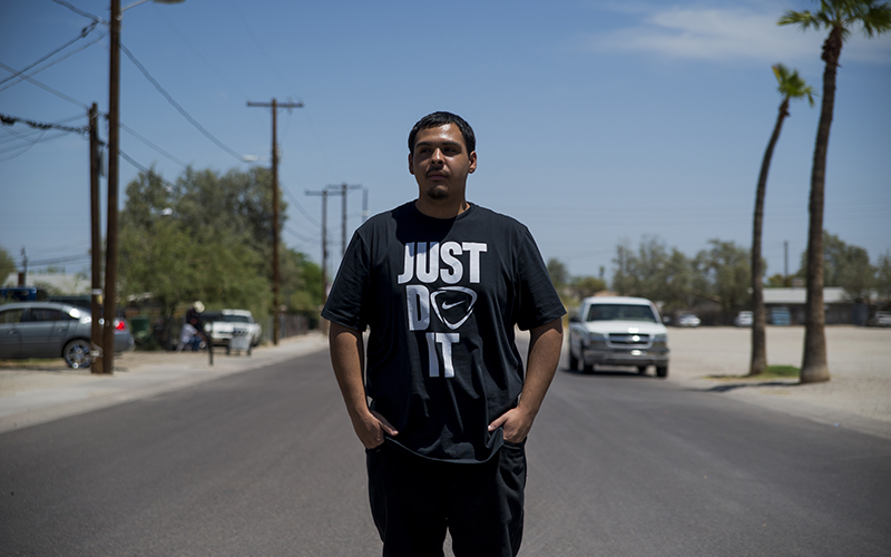 David Castorena, 24, of Chandler, Arizona, stands in the street of a small, largely-Latino community where he attends church. Castorena said he does not plan to vote in the upcoming November Election because he thinks that Donald Trump will win either way. (Photo by Roman Knertser/News21)