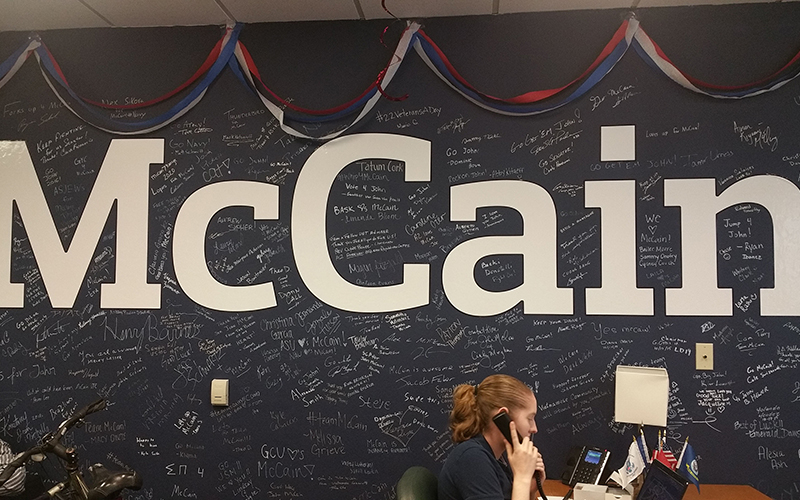 A McCain intern answers questions at Phoenix campaign headquarters. (Photo by Socorro Carrillo/Cronkite News)