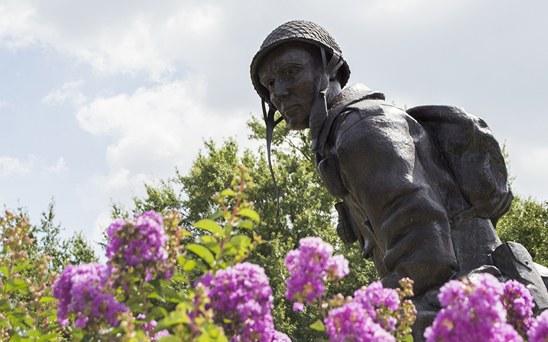 "The ""Iron Mike"" statue on the grounds at Fort Bragg in North Carolina represents the ""courage, dedication, and traditions"" of paratroopers from the 82nd Airborne Division. (Photo by Michael Olinger/News21)"