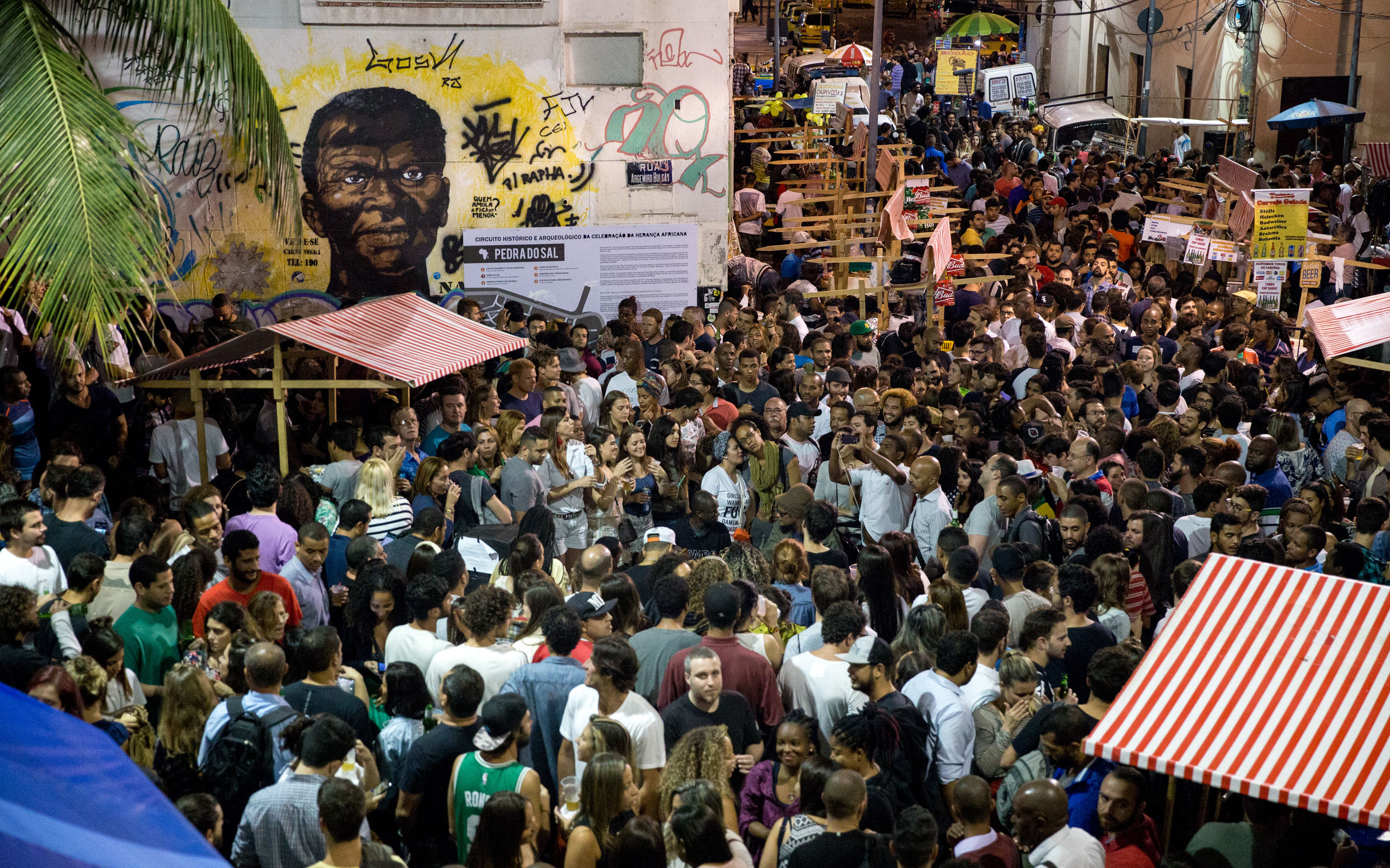 People gather to hear musicians preform samba at Pedro do Sal in Rio de Janeiro on Monday, Aug. 8, 2016.