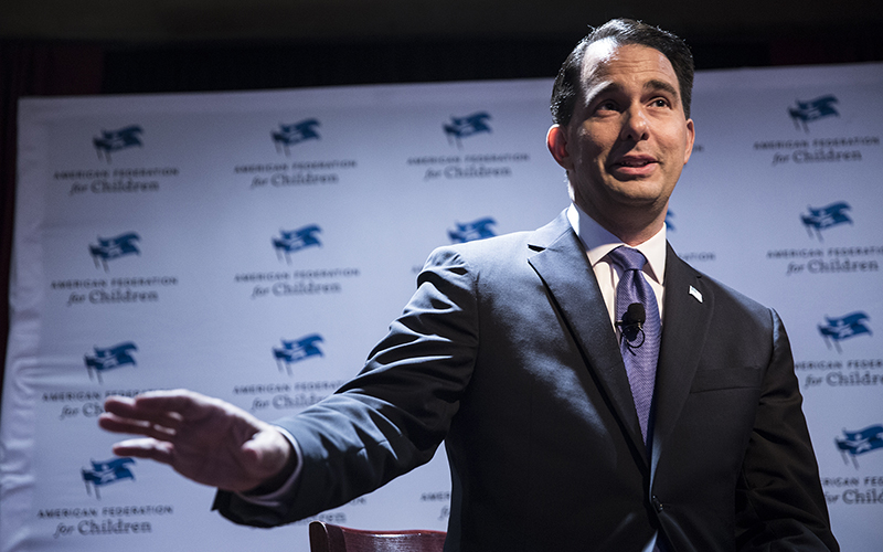 Wisconsin Gov. Scott Walker speaks at the Republican National Convention. Walker supports ID laws to counter fraud even though voter fraud is rare in the state. (Photo by Emily Mahoney/News21)