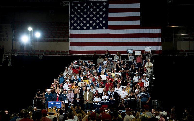 Republican presidential candidate Donald Trump holds a rally in Phoenix. Trump has claimed fraudulent voters will be able to cast multiple ballots without voter ID laws in place. (Photo by Roman Knertser/News21)