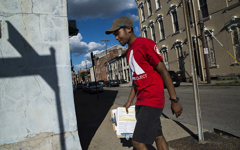 Dallas Stokes, a volunteer for the AMOS Project, a nonprofit social justice organization in Cincinnati, registers people to vote. In May, a federal judge struck down a restrictive voting law in the state that Republicans said was meant to curtail voter fraud. (Photo by Roman Knertser/News21)