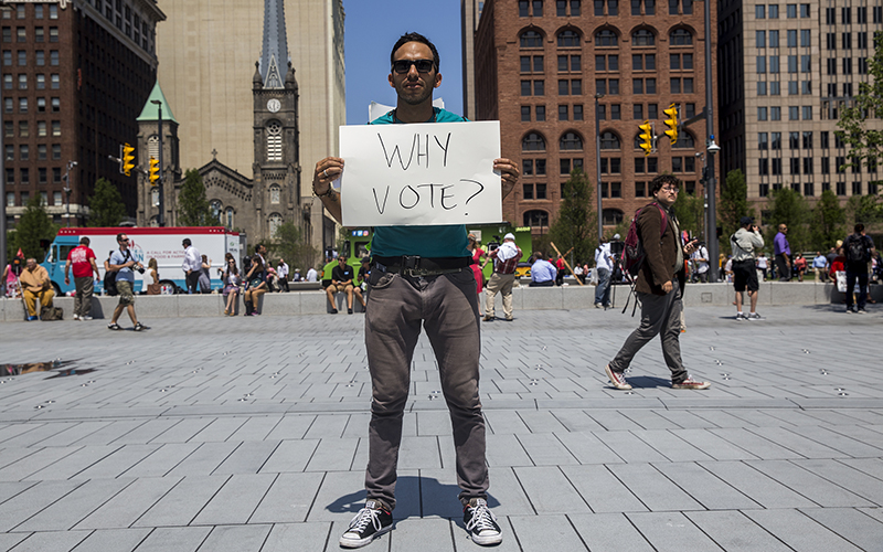 Uscav Mosco, 35, traveled from Santa Barbara, California, to protest in front of the  Republican National Convention in Cleveland. Protesters gathered in Public Square throughout the week. Mosco doesn't support Donald Trump or Hillary Clinton for president. He felt that both candidates do not represent what the majority of Americans want in a president. (Photo by Emily Mahoney/News21)