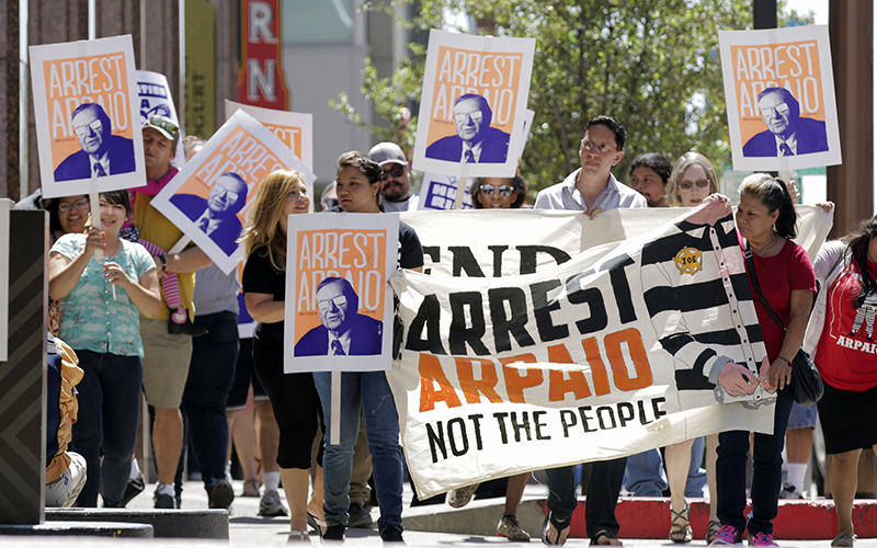 Several dozen protesters took to the streets of downtown Phoenix on Monday to demand the arrest of Maricopa County Sheriff Joe Arpaio. (Photo by Brian Fore/Cronkite News)