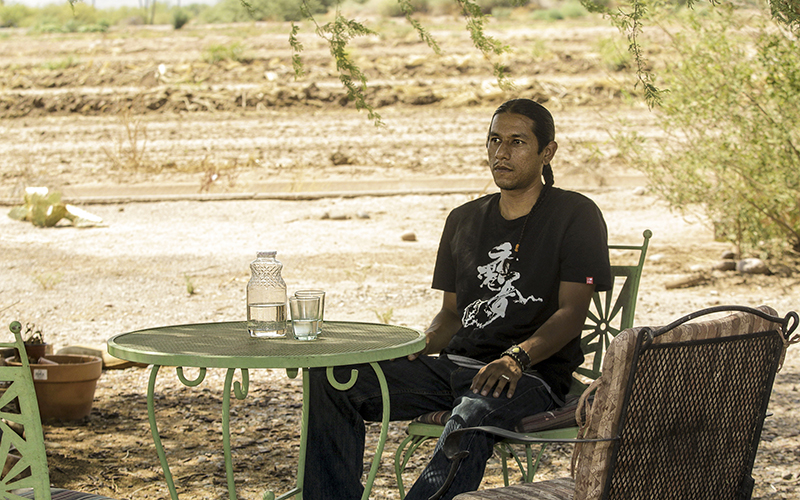 Pii Paash tribal member Reuben Cruz says his small tribe's environmental concerns are not being taken into account as the Gila River Indian Community prepares to trade drinking water for reclaimed water to irrigate fields. (Photo by Isabel Menzel/Cronkite News)
