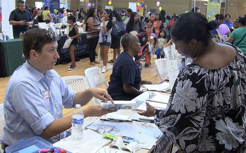 Insurance customers who signed up for coverage under Obamacare at enrollment fairs like this one two years ago will likely face much higher premiums when they re-enroll this year. (Cronkite News file photo)