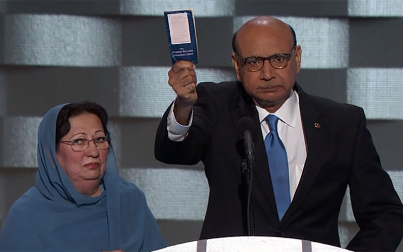Khizr Khan, with his wife, Ghazala, holds up a pocket copy of the Constitution, which he suggested Donald Trump has not read, during a Democratic National committee speech.