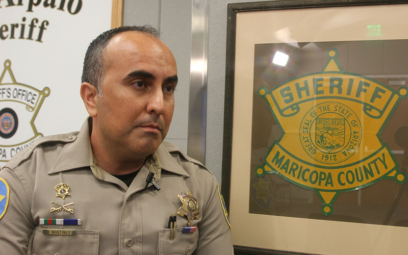 """Deputy Hector Martinez of MCSO talks about the importance of """"community policing"""" and not having what he calls the """"cop mentality"""" of us versus them. (Photo by Elizabeth S. Hansen/Cronkite News)"""