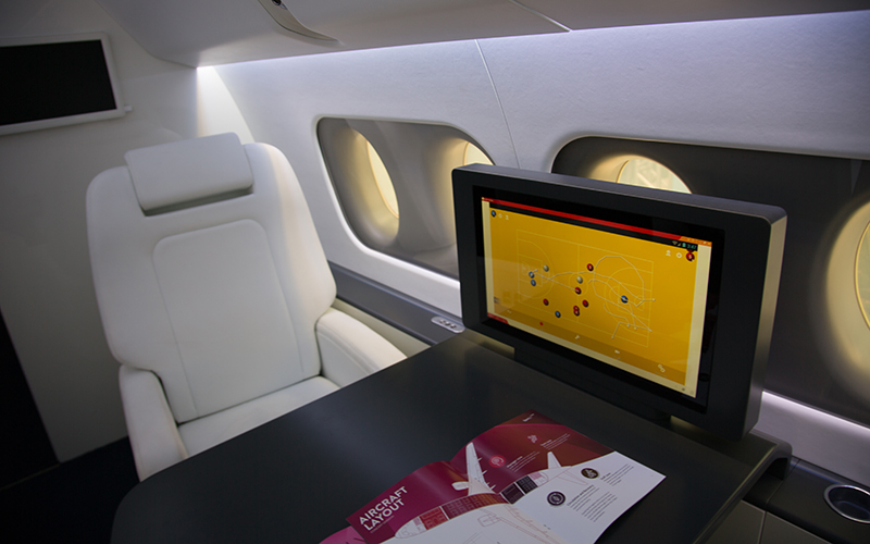The Sukhoi SportJet features a table and monitor where team coaches can sit and share plays, strategies and team footage with the athletes. A full-scale model of the plane's interior was on display at the Marimbas Club in Rio de Janeiro. (Photo by Graham Bosch/Cronkite News)