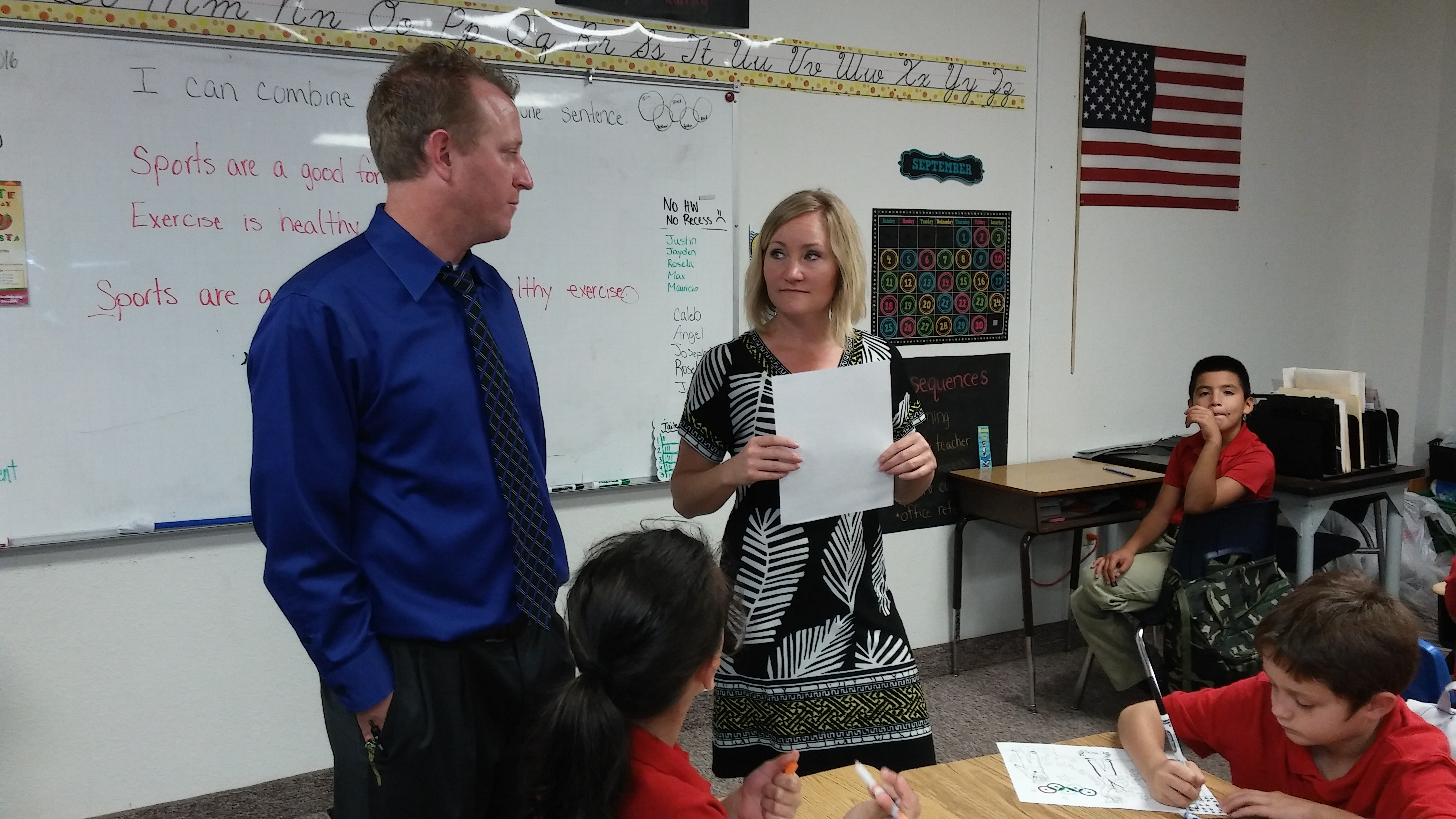 Heritage Elementary school Glendale campus Principal Justin Dye and fourth grade teacher Kyle Shippy discuss the day's lesson plan.