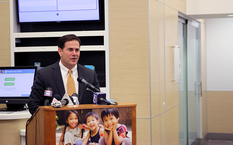 Arizona Gov. Doug Ducey gave a news conference at a Walgreens store on 36th Street and Camelback Road on Friday morning. Ducey and Walgreens officials unveiled a new prescription drop-off system for the pharmacy chain's Arizona stores. (Joshua Bowling/Cronkite News)