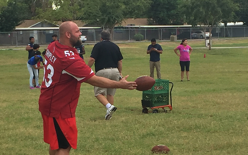 Cardinals center A.Q. Shipley worked with students at Holdeman Elementary School in Tempe Tuesday. (Photo by Alex Stewart/Cronkite News)
