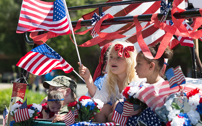 Several Arizona officials said they expect to be on the campaign trail hitting parades and other events over Labor Day weekend, the traditional start of the campaign season. (Photo by Robert Couse-Baker/Creative Commons)