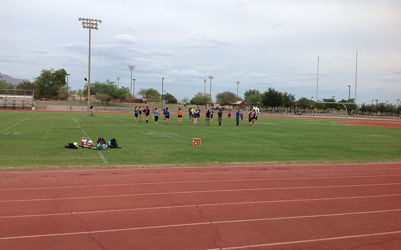 The Apache Junction High School band practices after school on a Friday afternoon. School administrators said activities such as football and band practice have not been affected by a four-day school week with school closed on Friday.  (Photo by Alejandro Barahona/Cronkite News)