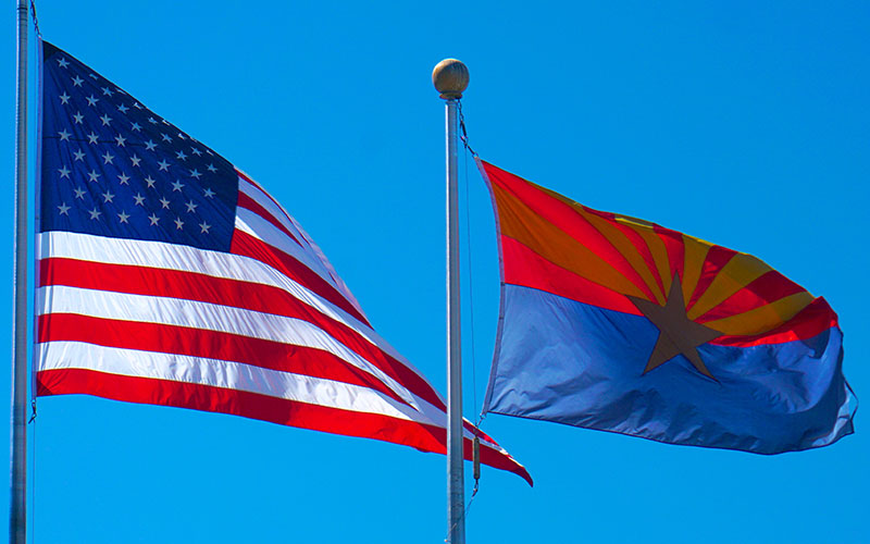 USA and Arizona Flags (Photo by Ted Eytan via Creative Commons) Photo-https://www.flickr.com/photos/taedc/16807610186/ Ted Eytan-https://www.flickr.com/photos/taedc/ CreativeCommons-https://creativecommons.org/licenses/by-sa/2.0/