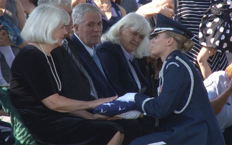 Members of Elaine Harmon's family are presented with a flag during an inurnment ceremony for the former Women Airforce Service Pilot at Arlington National Cemetery. (Photo by Claire Caulfield/Cronkite News)