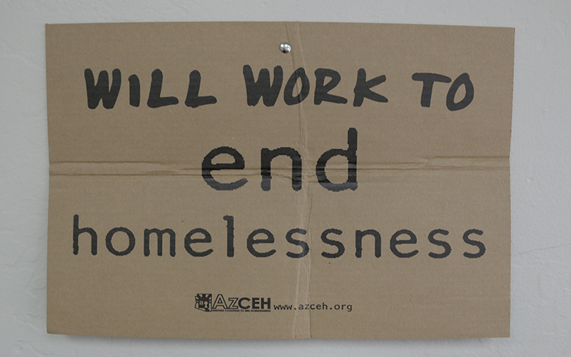 A sign is displayed in the offices of the Arizona Coalition to End Homelessness. (Photo by Tyler Petersen/Cronkite News)
