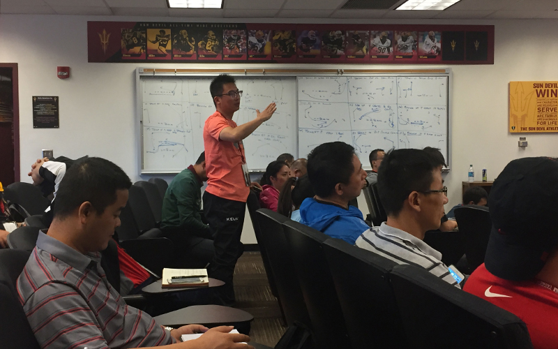 A Chinese coach asks a question at a lecture about track and field. (Photo by Ryan Decker/Cronkite News)