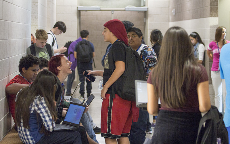 Students gather between classes at Phoenix Coding Academy, which opened its doors in August. (Photo by Ally Carr/Cronkite News)