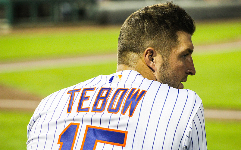 Scottsdale Scorpions outfielder Tim Tebow watches from the dugout during the team's matchup against the Surprise Saguaros, Wednesday, Oct. 19 in Scottsdale. (Photo by Nicole Vasquez/Cronkite News)