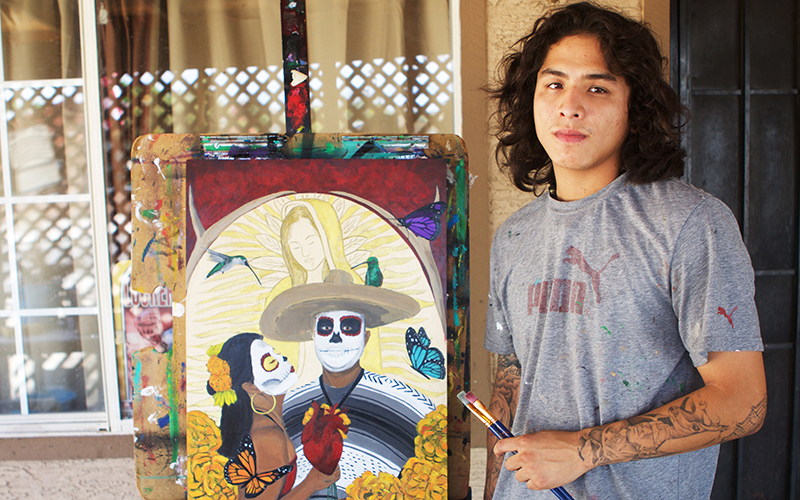 Guadalupe resident and artist Jose Lopez, 23, hasn't voted in previous elections. He says many of his fellow residents see no point to voting because nothing changes in his town. (Photo by Andres Guerra Luz/Cronkite News)