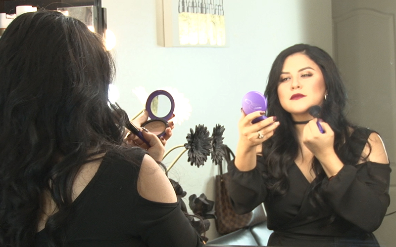 Makeup artist Gabriela Elizalde uses her MAC Selena Collection sparingly because the sold-out make up line won't be available again until early January.  (Photo by Lillian Griego/Cronkite News)