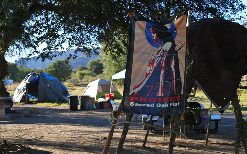 Members of the San Carlos Apache Tribe set up a camp near the entrance of Oak Flat campground showing they oppose a proposed copper mine. (Photo by Bri Cossavella/Cronkite News)