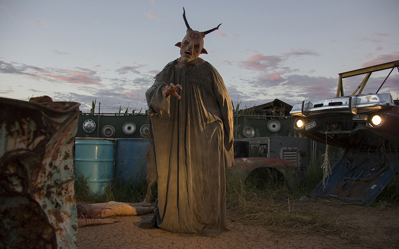 The corn fields at Fear Farm are transformed into something terrifying with sets, actors, costumes, makeup, and darkness. (Photo by Ally Carr/Cronkite News)