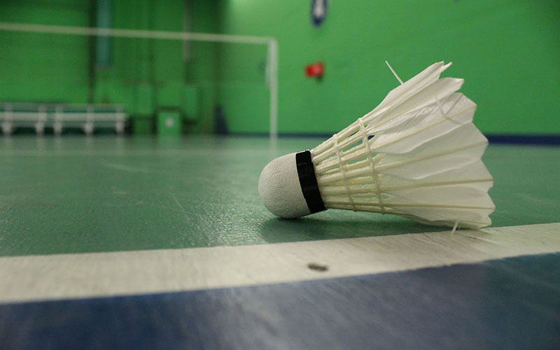 A shuttlecock lies on the court at the Arizona Badminton Center. (Photo by Michael Boylan/Cronkite News)