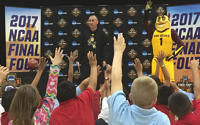 "Students at Aguilar Elementary School in Tempe respond after ASU men's basketball coach Bobby Hurley asked, ""Who likes basketball?"" (Photo by Ryan Decker/Cronkite News)"