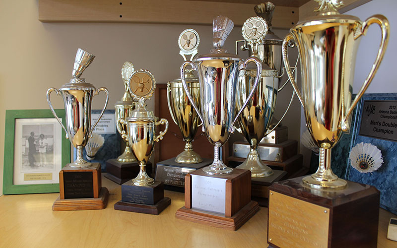 Guy Chadwick won 20 national championships as a player and coach of Arizona State's badminton team, and he still has some of those trophies displayed in the lobby of the Arizona Badminton Center. (Photo by Michael Boylan/Cronkite News)