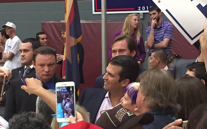 Donald Trump Jr. takes pictures with supporters at a rally on Arizona State University's Tempe campus. (Photo by Ryan Dent/Cronkite News)